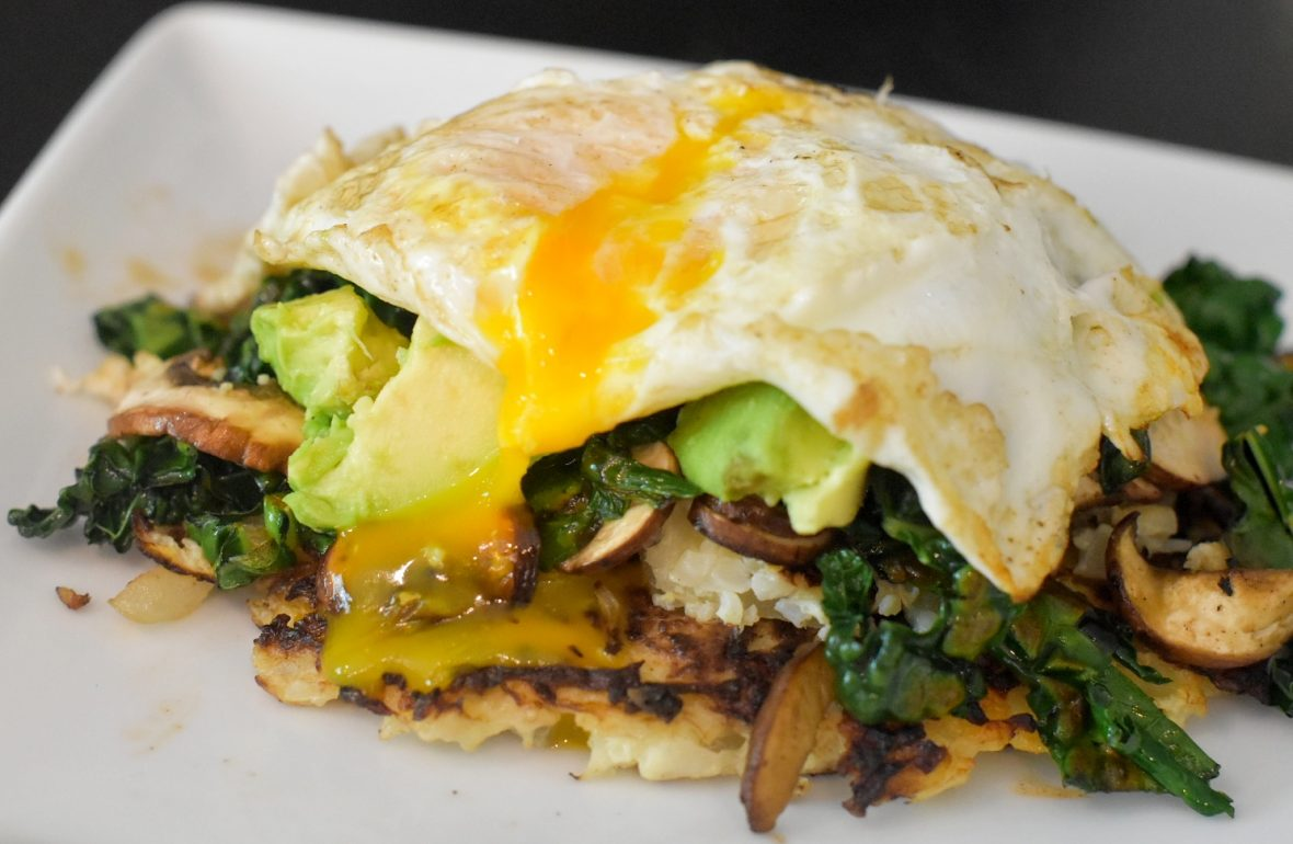 cauliflower hash browns with veggies, avocado and egg